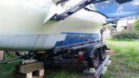 This is tricky business requiring careful lifting of the boat with jacks and blocks