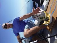 Bill produces a yummy bowl of pineapple on our day sail around Carmen.